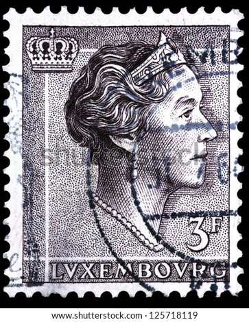 "LUXEMBOURG - CIRCA 1960: A stamp printed in Luxembourg shows portrait of Grand Duchess of Luxembourg Charlotte, without inscription, from the series ""Grand Duchess of Luxembourg Charlotte"", circa 1960"