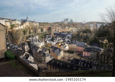 Luxembourg city skyline - Aerial view of The Grund at night with St Michaels Church on background - Luxembourg City, Luxembourg Stock photo ©