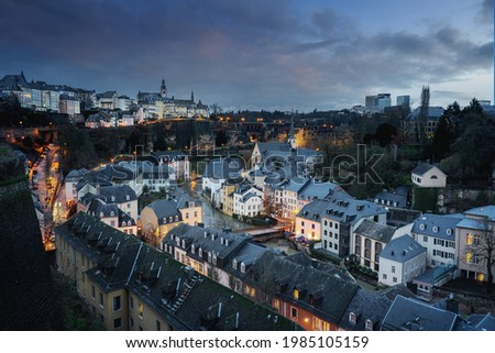 Luxembourg city skyline at night - Aerial view of The Grund with St Michaels Church on background - Luxembourg City, Luxembourg Stock photo ©
