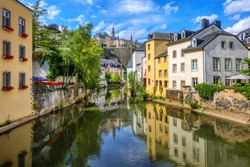 Luxembourg city, the capital of Grand Duchy of Luxembourg, view of the Ctiy center, Old Town, Grund quarter and Alzette river on a sunny summer day