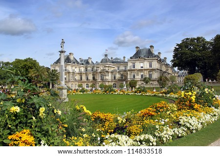 Luxembourg palace with flowers lawn in front. Paris, France