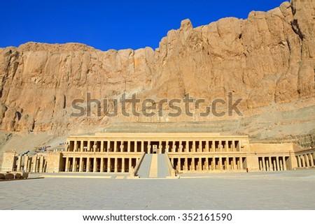 LUXOR, EGYPT - DECEMBER 3 2015: Mortuary Temple of Queen Hatshepsut is located beneath the cliffs on the West Bank of the Nile near the Valley of the Kings. #352161590