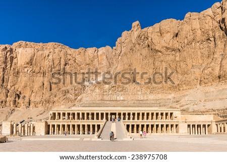 LUXOR, EGYPT - NOV 29, 2014: Queen Hatshepsut's temple (Dayr el-Bahari or Dayr el-Bahri), part of the Theban Necropolis. #238975708