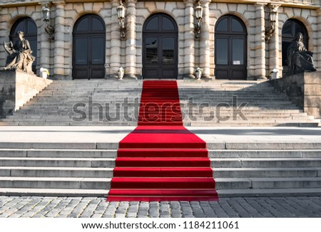 Luxorious noble red carpet on the historical stairs
