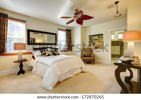 Luxuriant bright bedroom with contrast dark brown wooden furniture