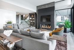 Luxurious and elegant living room with slate and dark yellow tones