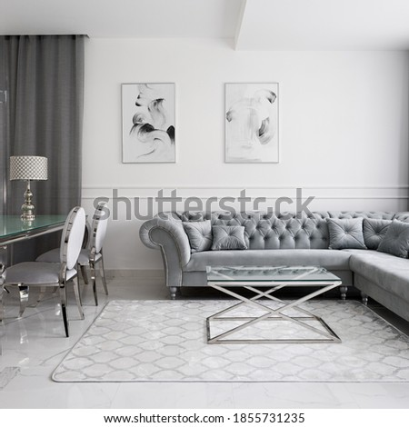 Luxurious and glamour style living room interior with quilted corner sofa, glass coffee and dining tables and fancy chairs