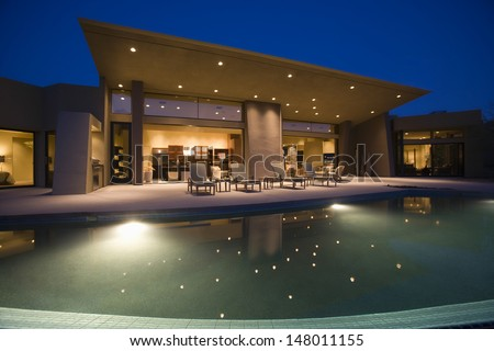 Luxurious and modern house with swimming pool at night for Modern house at night