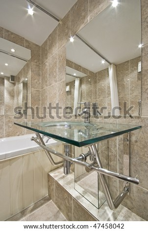 Luxurious Bathroom Detail With A Designer Glass Wash Basin And ...