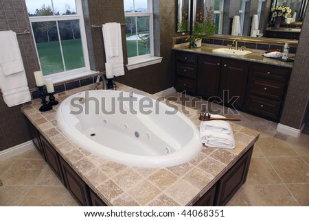 Luxurious bathroom with a modern tub and golf course view.