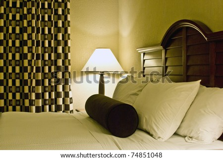 Luxurious bedroom with comfortable bed sets of fluffy pillows and fresh linens - stock photo
