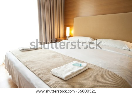 Luxurious bedroom with two towels on the bed