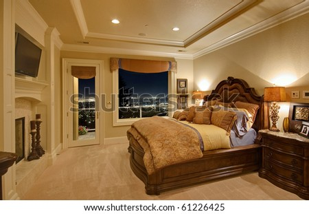 Luxurious bedroom with view of city below
