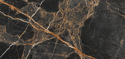 Luxurious black agate marble texture with golden veins, polished marble quartz stone background striped by nature with a unique patterning, it can be used for interior-exterior home décor tile.