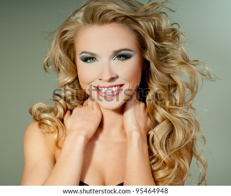 luxurious blonde with curly hair