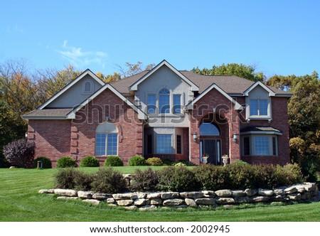 Luxurious brick executive house with blue sky