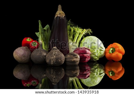 Luxurious colorful fresh vegetable isolated on black background. Beet, capsicum, cabbage, chinese cabbage, fennel, black radish and eggplant. Fresh healthy eating.