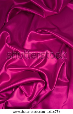 Luxurious deep pink satin/silk folded fabric, useful for backgrounds