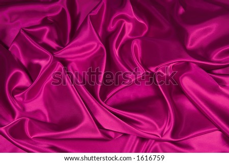 Luxurious deep pink satin/silk folded fabric, useful for backgrounds - stock photo