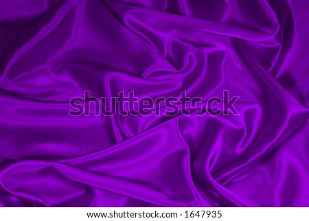 Luxurious deep purple satin/silk folded fabric, useful for backgrounds