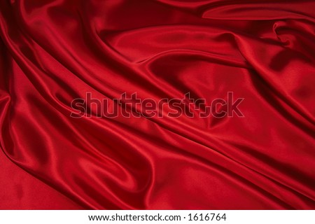Luxurious deep red satin/silk folded fabric, useful for backgrounds