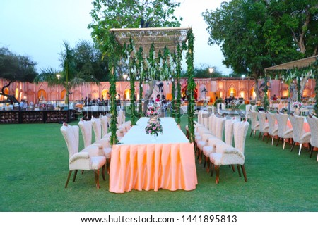 Luxurious dinner table and chairs, rich decorated with flower pots, Indian Wedding setup - Image