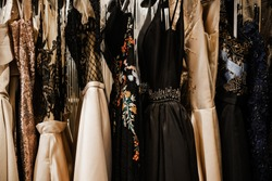 Luxurious evening night out sparkling dresses hanging on the rack. High fashion concept, haute couture, designer