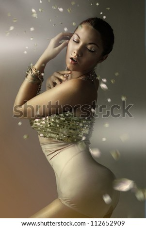 Luxurious girl in gold glitter - stock photo