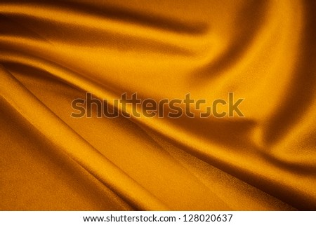 luxurious gold satin background close up