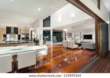 Luxurious home interior with large sliding doors #129899264