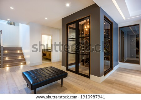 Luxurious home interiors with rich wood and golden tones Photo stock ©