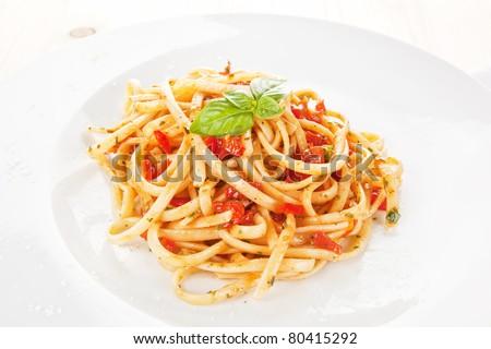 Luxurious homemade spaghetti with tomato sauce on white plate. Traditional italian cuisine. - stock photo