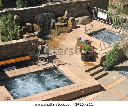 Luxurious hotel patio with hot tubs.