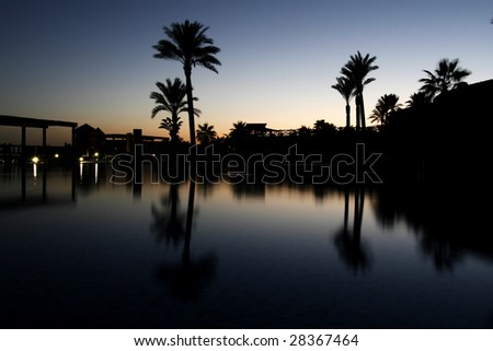 luxurious hotel pool by night - stock photo