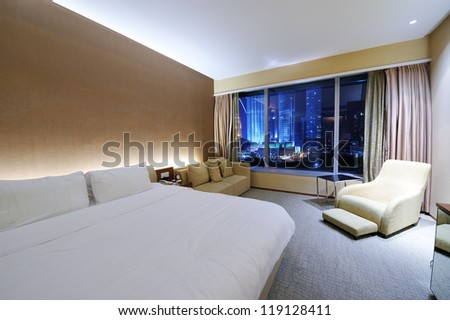 Luxurious hotel room interior with large window