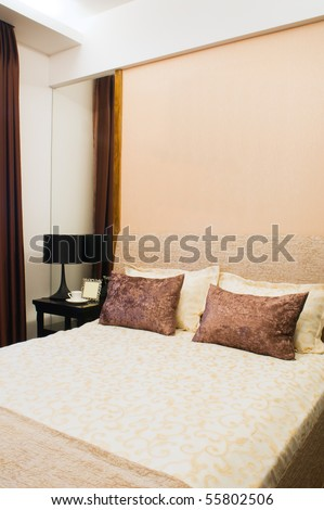 Luxurious hotel room with king sized bed - stock photo