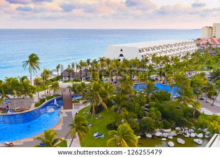Luxurious hotel with a swimming pool at evening in Cancun, Mexico. - stock photo