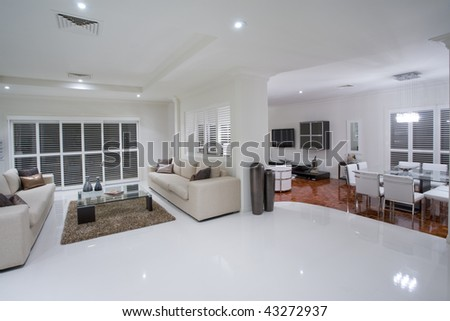 Luxurious living rooms with dining table in the background