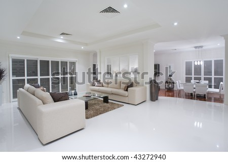 Dining Room on Luxurious Living Rooms With Dining Table In The Background Stock Photo