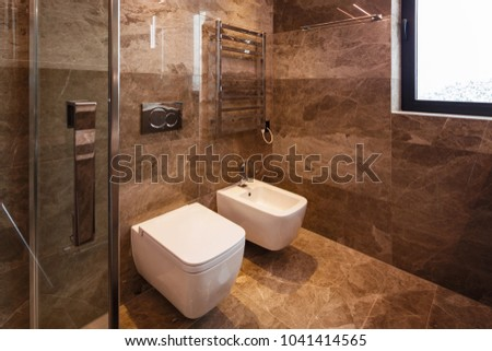 Luxurious marble bathroom with window. Nobody inside #1041414565