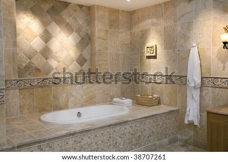 Luxurious modern bathroom with bathtub and hanging bathrobe
