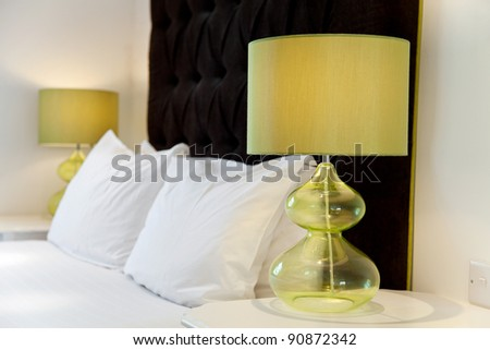 Luxurious modern bed design and bedside lamps
