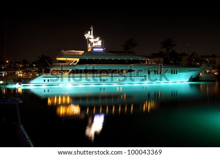 luxurious modern private yacht at the pier at night