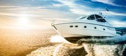 Luxurious motor boat sailing the sea at dawn