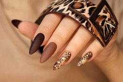 Luxurious multicolored manicure with animal design on long nails.