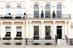 Luxurious old apartament house with a white facade, , Kensington, London, UK