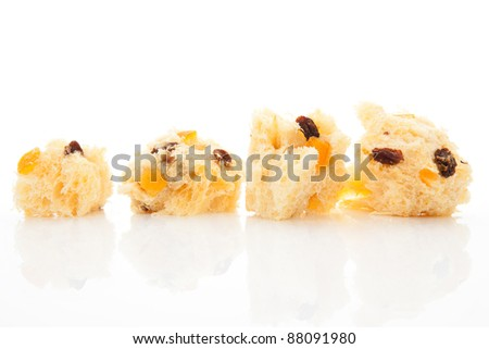 Luxurious panettone pieces isolated on white background. Festive food background.