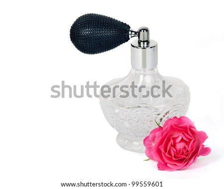 Luxurious perfume bottle atomizer with flower blossom isolated on white background. - stock photo