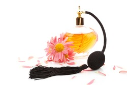 Luxurious perfume bottle atomizer with flower blossom isolated on white background. Feminine beauty concept.