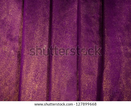luxurious purple background with gold sequins